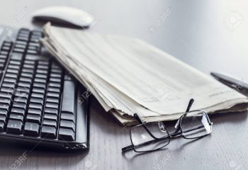 79164055-newspaper-with-keyboard-on-table